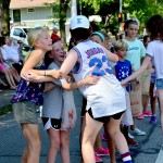 Sophomore Libby Frye hugs Belinder students on the side of the street. Photo by Diana Percy