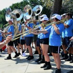 The marching band plays at the Village before the Pep Rally begins. Photo by Diana Percy