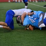 Senior and Varsity football player Mike Bamford gets tackled by a Gardener-Egerton football player. Photo by Diana Percy