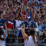 The Shawnee Mission East student section raises their hands in the rollercoaster chant. Photo by Diana Percy