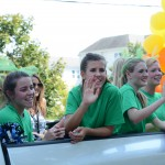 "Juniors Mallory Grey and Jacqueline Hockenburg wave to the crowd from the ""Wizard of Oz"" themed cheer float. Photo by Haley Bell"
