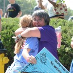 Former teacher Señora Detrixhe hugs junior Rebecca Sheridan during the parade. Photo by Haley Bell