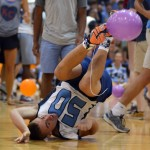 Freshman Alex Stubbs rolls on the ground to recover from being tripped in the balloon contest. Photo by Kaitlyn Stratman