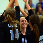 Sophomore Victoria Yedo laughs at something her coach said during their huddle. Photo by Kaitlyn Stratman