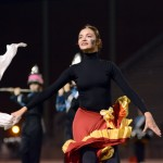 Sophomore Savannah Worthington smiles to the crowd as she dances at halftime. Photo by Annie Lomshek
