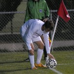Senior Jacob Riley places the ball for a corner kick.   Photo by Tess Iler