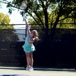 Freshman Lucy Kendall serves, starting the match. Photo by Maddie Smiley