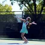Freshman Lucy Kendall serves the ball, starting the match. Photo by Maddie Smiley