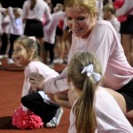 Junior Hope Hess crouches down to talk to the little Lancers. Photo by Ellie Thoma
