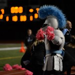 Lancer plays with cheerleader's poms.