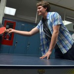 Junior Parker Bennion waits for the ping pong ball during a match.
