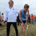 "Sophomore Sam McKnight is comforted by Coach Pennignton before he gets water after the race. ""I felt like crap afterwards because i didn't eat anything that morning. I just kept dry heaving"". Photo by Joseph Cline"
