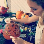 "Sophomore, Chloe Calderon-Housh decorating her pumpkin in a ""Pop Art"" style."