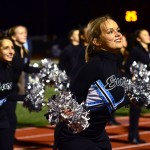 Junior Isa Tamburini dances on the track with the rest of drill team. Photo by Diana Percy