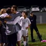 Senior Luke Ehly embraces his dad after being recognized during senior night. Photo by Diana Percy