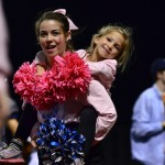 Junior Tyler Lockton carries a little Lancer to her friends. Photo by Diana Percy