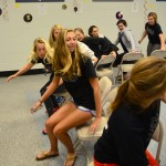 Sophomore Sarah Wilcox, Larkin Mcliney, and Maddy Muther play Mole-sicle chairs to win candy. Photo by Diana Percy