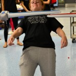 Sophomore Libby Frye ducks under light sabers in Light Saber Limbo. Photo by Diana Percy