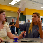 Juniors Kylie Rellihan and Chloe Alexander talk about the problem they just solved. Photo by Jemima Swindells