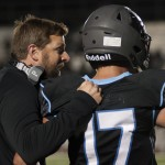 Player, Simon Bradley, gets a pep talk from coach Delaney before going back into the game. Photo by Ava simonsen