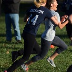 Senior Halle Connelly runs towards end zone, while junior Hope Hess chases after her. Photo by Morgan Browning