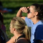 Junior Mallory Gray watches from the sideline after she is told she can't play, because she got hurt in the first half of the game. Photo by Morgan Browning