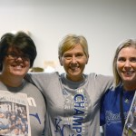 attendance workers Jody Gustafson, Kristin Powell and secretary Jody Evert all bore their Royals gear in light of the win.