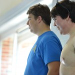 Seniors Joe Levin and Stephen Gill smile while watching one team struggle to get across the pool. Photo by Abby Blake