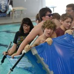 Seniors Chloe Neighbor, Bryce Flora, Joe Levin, Michael Poskin, and Logan Bennion try to keep the boat from tipping over after nearly the entire class gets into the boat. Photo by Abby Blake