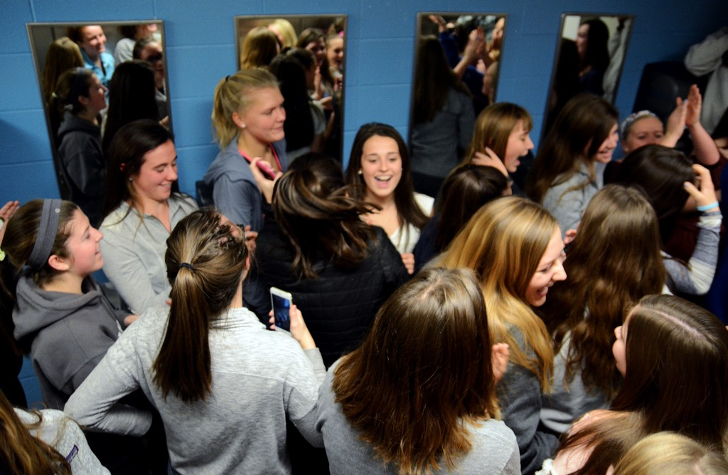 "Freshmen to senior girls continually chant ""La Toilette"" in the fifth floor girls' bathroom, while senior Sarah Allegri plays music with her speaker. ""La Toilette"" is a club made up of about 165 girls. Photo by Morgan Browning"