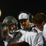 Coach Ufford tells players about the next play on the sidelines. Photo by Haley Bell