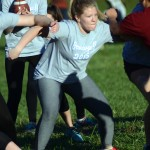 "Senior Abby Hans fights off the junior girls so her teammate can pass the ball. ""We actually put a lot work into powder puff because we had several practices leading up to the game."" Photo by Kaitlyn Stratman"