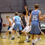 Freshman Hudson Churchill and his teammates play in the Freshmen boys basketball scrimmage. Photo by Diana Percy