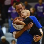 Three year old Tyler Reiger, a young cancer patient, makes a special appearance at the Varsity game. Photo by Diana Percy