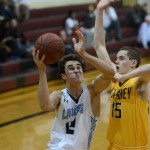 Senior Luke Ehly fends off Vikings junior Eric Krus