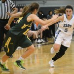 Junior Kyle Haverty moves to avoid her defender as she runs towards the basket. Photo by Haley Bell