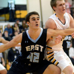Senior Luke Ehly boxes out his defender under the basket.  Photo by Tess Iler