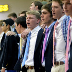 Senior boys sing the school song after a tough loss.  Photo by Tess Iler