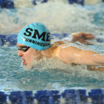 Sophomore Tyler Cunningham competes in the 100 yard butterfly. He took 10th place with a time of 54:20. Photo by Haley Bell