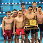 The juniors on the swim and dive team pose for pictures with the State Championship trophy. Photo by Haley Bell