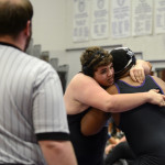 Sophomore OJ Ludwig grips his opponent at the start of the match. Photo by Katie Lamar
