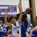 Senior Alex Glaser blocks a shot with his body. Photo by Diana Percy