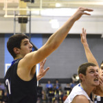 Seniors Jay Guastello and Luke Ehly fight with Olathe South for the rebound. Photo by Diana Percy