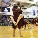 """The varsity Lancer Dancers perform their lyrical routine to the song """"Lean on Me"""" at halftime. Photo by Diana Percy"""