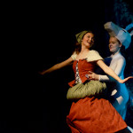 Sophomore Savanna Worthington as Cinderella and senior Emily Meiring dance together in the show. Photo by Maddie Smiley