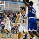 Sophomore Collyn Lowry blocks Rockhurst player. Photo by Maddie Smiley