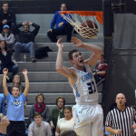 Senior Jay Guastello dunks the ball during the fourth quarter of the game. Photo by Abby Blake