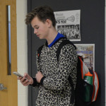 Freshman Kevin Grinstead waits after school on pajama day. Photo by Callie McPhail