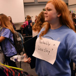 Junior Carson Camp walks to put her choir folder away while wearing her homemade Harry Potter costume for Monday's theme. Photo by Morgan Browning