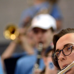 Sophomore Alex White plays the flute in the pep band during a time out.  Photo by Elaine Chamberlain